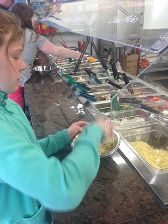 Prince George, Canada: My daughter selecting chow mein noodles... whatever she pleases