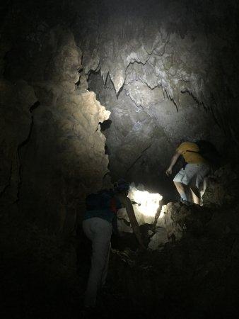Climbing within Actun Chapat