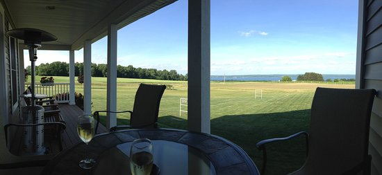 Penn Yan, NY: Happy hour on the porch overlooking Seneca Lake and vineyards