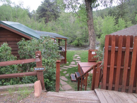 Paradise on the River: our cabin entrance. Hot tub on right, cabin on left.