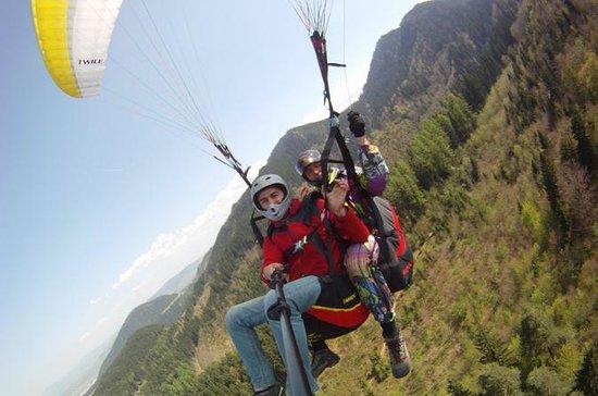 Paragliding tandem flight near...