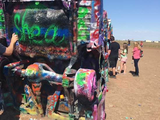 Cadillac Ranch: Take pictures of your work because the next person could paint over your art.