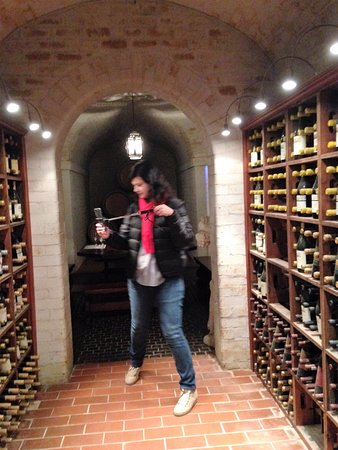 Constantia, South Africa: Going into Duggie's Dungeon for our tasting. Claudia from Brazil.