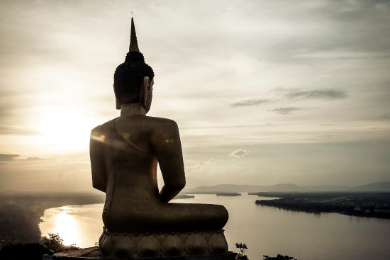 The big Buddha at Phou Salao overlooking Pakse and the Mekong