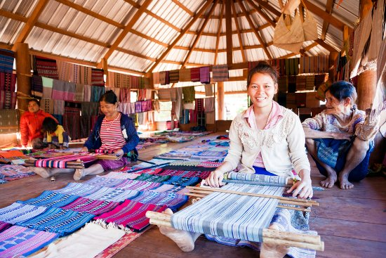 Salavan Province, Lào: The Katu weavers of Ban Houay Houn selling their textiles at the community sala