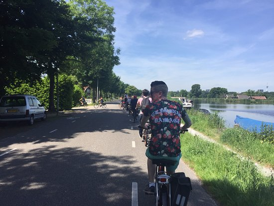 Joy Ride Tours: Biking along the river.