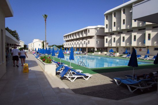 Kissos Hotel: Formal pool, superior room and freeform pool in background