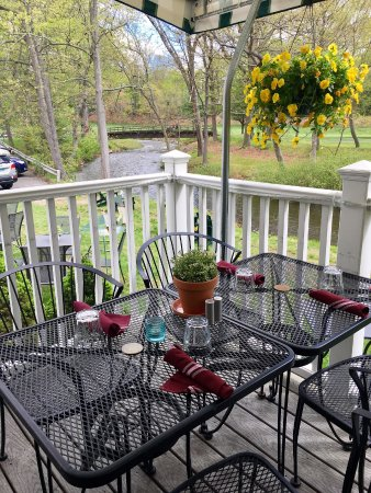 Naugatuck, CT: Patio dining overlooking Hop Brook