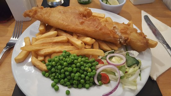 Tywyn, UK: My Fish and Chips after I had put my Peas on my plate and cut into the fish.