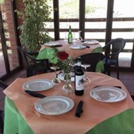 Cartajima, Espagne : Dining area windows open for the good weather and its next to the village pool!