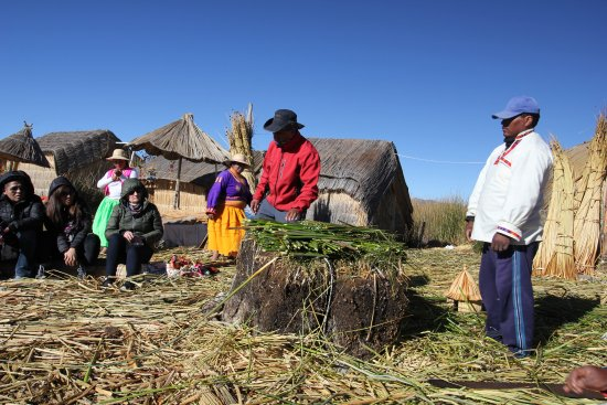 All Ways Travel: Local people of Uros explaining the way of the islands