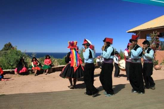 All Ways Travel: Local people of Taquile dancing before lunch
