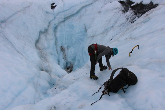 Glacier View, AK: Taking a look into a moulin on our Adventure Trek