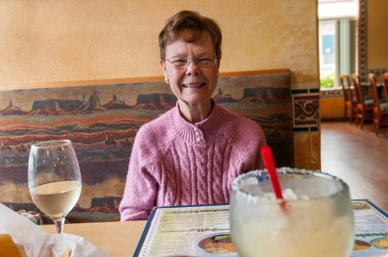 Gearhart, OR: My bride enjoying her wine as I enjoy my margarita.