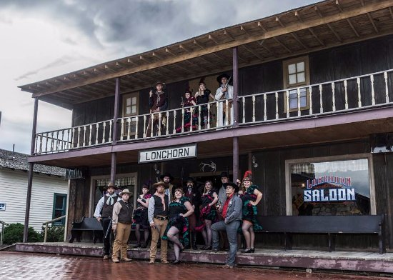 Burlington, CO: Can Can Dancers and Gunfighters in front of Longhorn Saloon