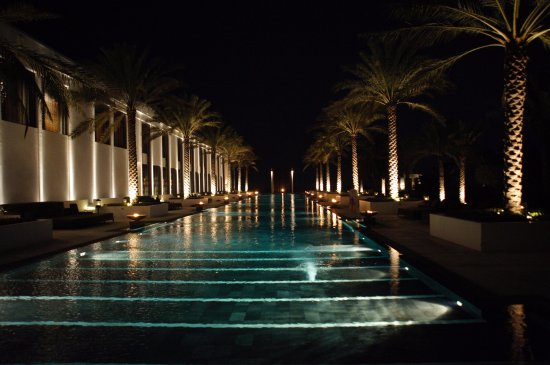 The Chedi Muscat – a GHM hotel: The 100m pool at night