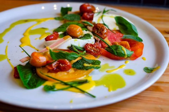 Prince George, Canada:  heirloom tomatoes, fior di late, nasturtium vinaigrette,  herbs & lettuces from our rooftop gar
