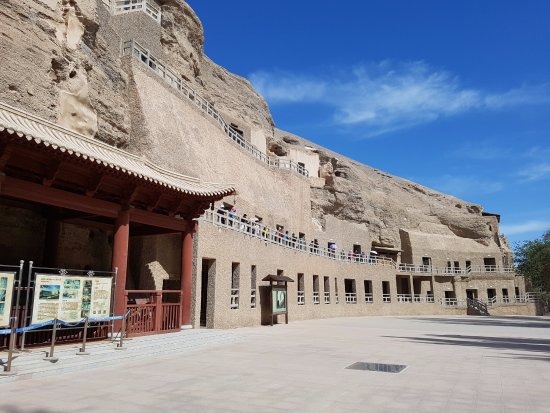Dunhuang, China: The cliff face is pockmarked with hundreds of man-made grottoes