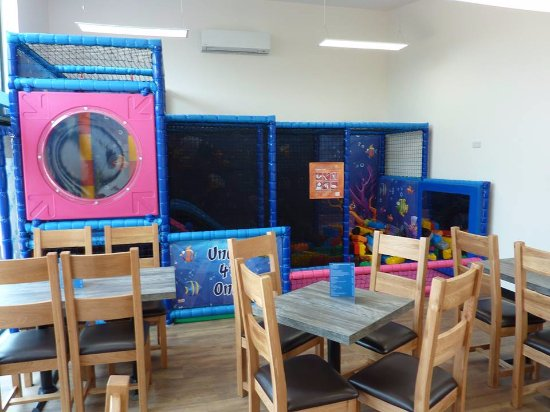Crediton, UK: Soft play area inside for toddlers, outside play towers for older kids