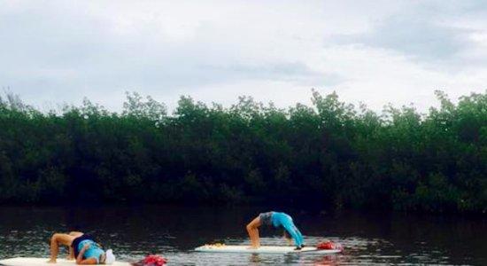 Lazy Dog Paddle Yoga : Bridge pose during paddle yoga with Tara.