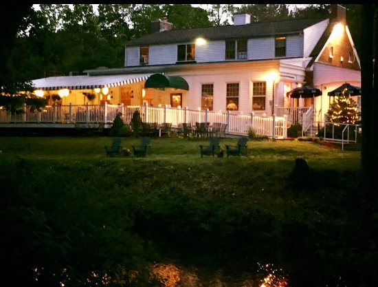 Naugatuck, CT: Jesse Camille's at night overlooking Hop Brook