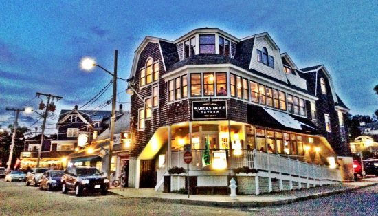 Quicks Hole Tavern at dusk in Woods Hole.