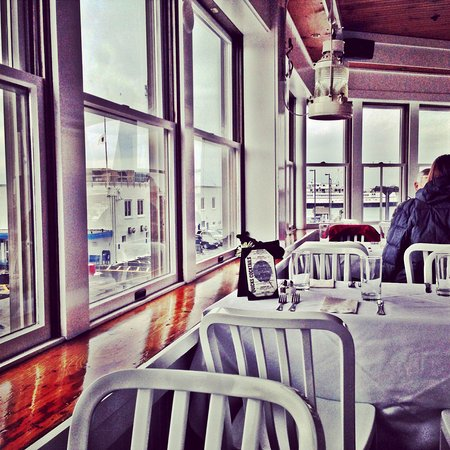 Tables with water views of the ferry and Woods Hole harbor.