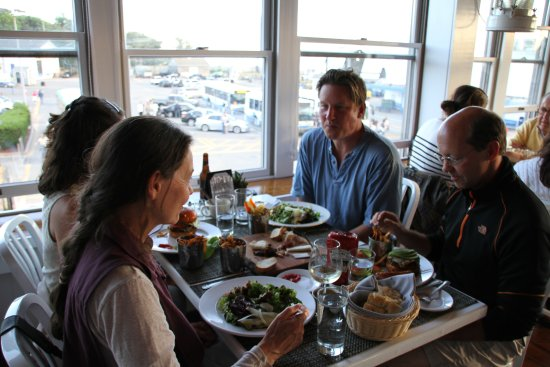 Guests enjoying the food, drink and water views at Quicks Hole Tavern in Woods Hole.