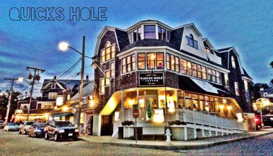 Quicks Hole Tavern sits like a ship next to the ships of Woods Hole harbor.