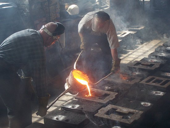 Ironbridge, UK: Pouring molten metal into the moulds.