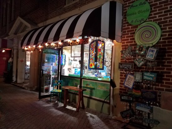 Cocoa, FL: We are easy to spot with our classic black & white striped awning.