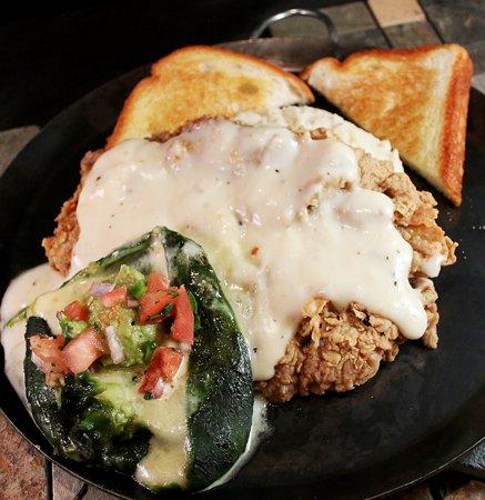 Haltom City, TX: Chicken Fried Steak with Pepper Jack Cheese relleno, guacamole, pico de gallo and peppered gravy