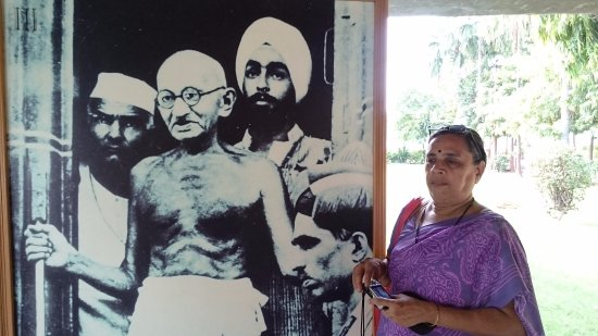 Sabarmati Ashram / Mahatma Gandhi's Home: Mom with the photo of Gandhiji and 2 others