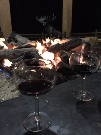 Brian Head, UT: Wine by the fire on the second floor balcony!