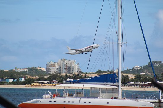 Simpson Bay, St. Maarten-St. Martin: Airplane taking off across the bay.