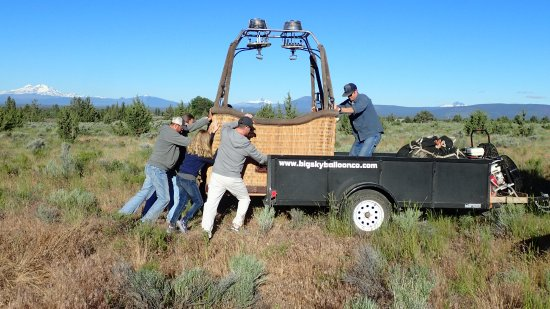 Redmond, OR: Loading the basket onto the trailer.