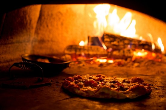 Hudson, WI: The wood fired oven prepares the best Island inspired pizzas!