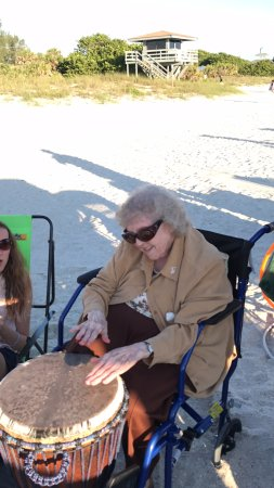 Nokomis, FL: The picture of my dreams - my 82 year-old aunt playing drums on the beach