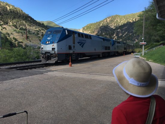 "Hotel Colorado: Amtrak's ""California Zephyr"" arriving at the depot in Glenwood Springs across the Colorado River"