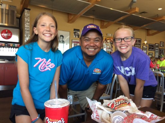 Raising Canes: The manager with my grandchildren.  We loved his smile and singing, visiting tables!