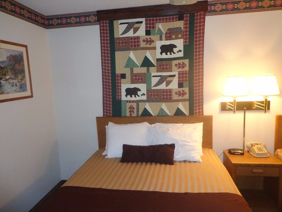 Columbia Falls, MT: Quilted bed decoration.
