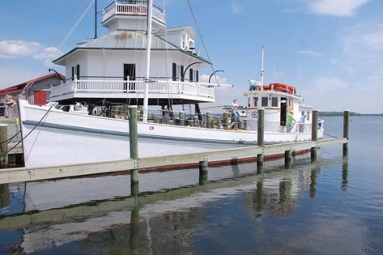 St. Michaels, MD: Hooper Strait Lighthouse and buyboat Winnie Estelle for public cruises