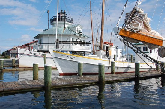 St. Michaels, MD: Hooper Strait Lighthouse and floating fleet of historic boats