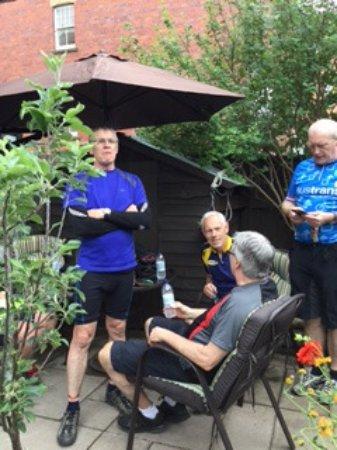 Llandrindod Wells, UK: the radnor ring cyclists enjoying the comunal garden