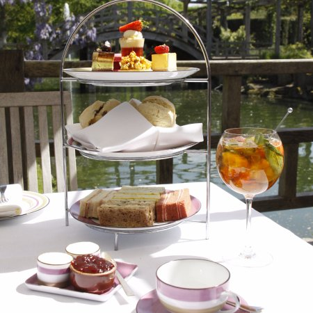 Egham, UK: Summer afternoon tea on the lawn overlooking the moat