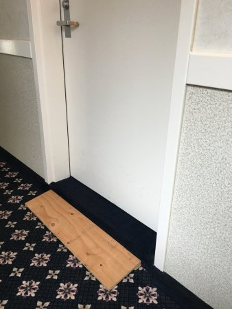 "Westerly, RI: wooden ledge put at front door of ""wheelchair accessible"" room due to large lip into the room"