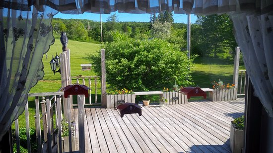 Baddeck, Canada: Looking onto back deck; humming bird feeders on the window.