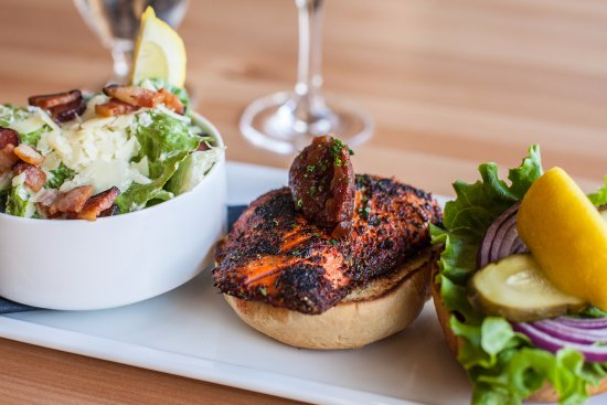 Langford, แคนาดา: Cajun Salmon Burger topped with a tomato jam and a side of our heart healthy caesar salad