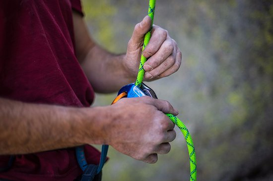 Olympic Valley, CA: Belaying a climber on Donner Summit.
