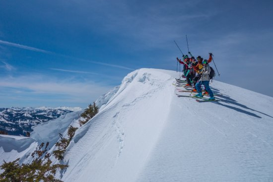 Olympic Valley, CA: Stoked skiers getting ready to drop into perfect snow
